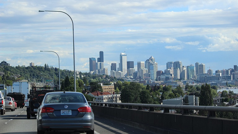 Image of southbound freeway traffic along Lake Union with view of downtown Seattle