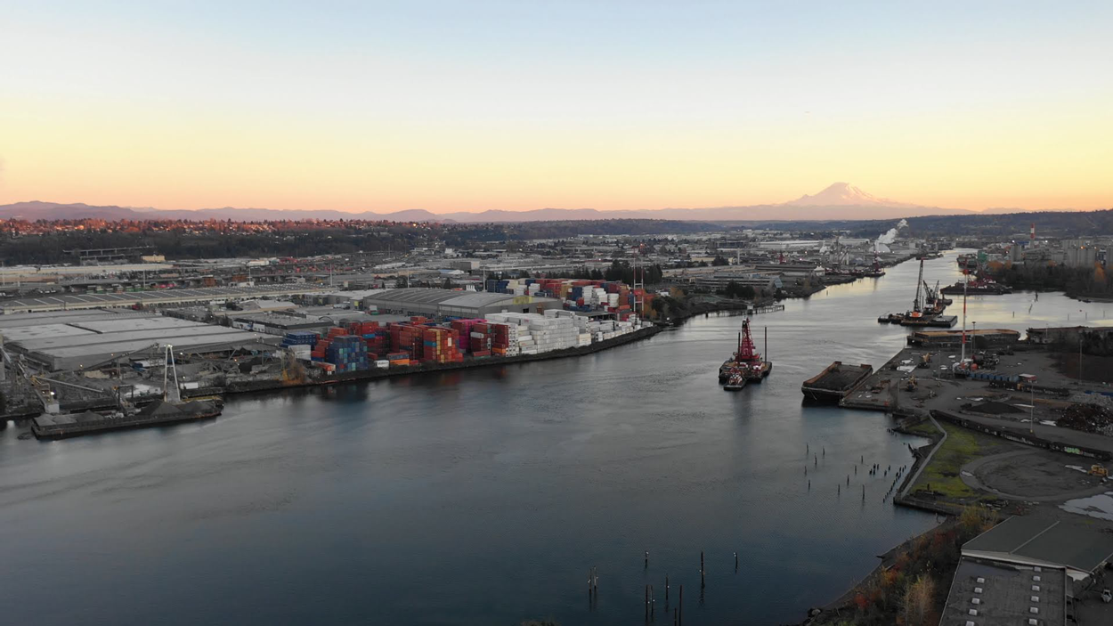 An aerial shot of the Duwamish River Valley with Mount Rainier in the distance.