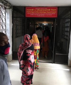 People wait in line for a TB clinic in Bangladesh.