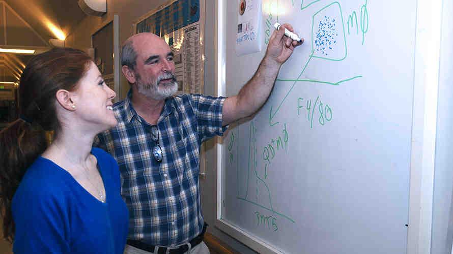 DEOHS Professor Terry Kavanagh talks with a student. Photo: Sarah Fish