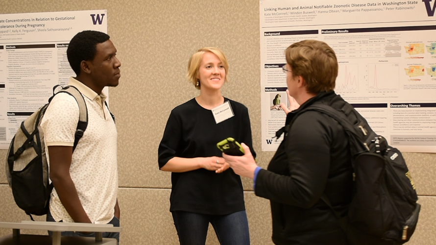 Kate McConnell talks with people about her research project at Graduate Student Research Day
