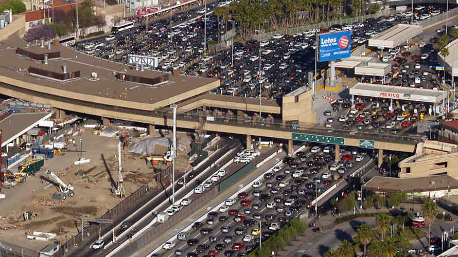 Image of the very heavy traffic across the border between the US and Mexico at San Ysidro from an arial view.