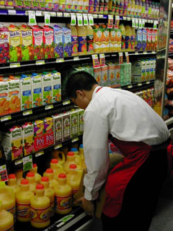 Young teen working in the grocery store