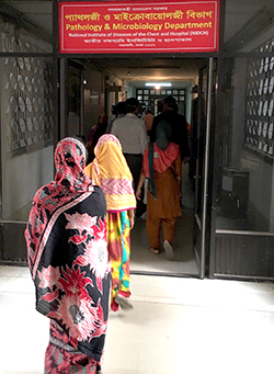 People wait in line at a TB clinic in Bangladesh. Photo: Gerard Cangelosi