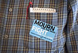 Workers' Memorial Day badge. Photo credit: Sarah Fish