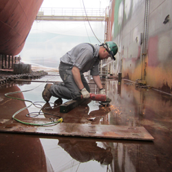 Gerry Croteau - Occupational Health and Safety - Welder working in a shipyard