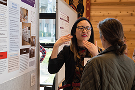 An MPH student shares her research findings. Photo by Elizar Mercado.