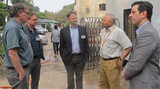 UW faculty, including Dr. Paul Drain and Dr. Jerry Cangelosi, outside of the cholera hospital with icddr,b Director Dr. Tahmeed Ahmed