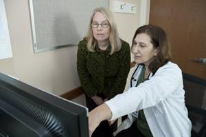 Clinic director Debra Milek (at right in photo) confers with research industrial Hygienist Nancy Beaudet.