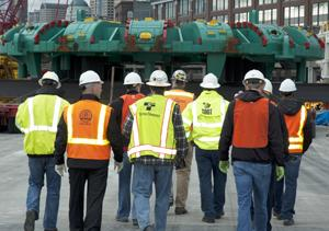 Course participants tour the State Route 99 tunnel boring machine at Alaska Way