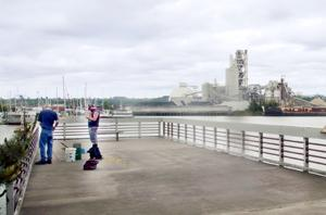 Two men fishing on the Duwamish River