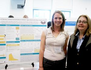 Carly Strecker with Professor Elaine Faustman at the Undergraduate Research Symposium