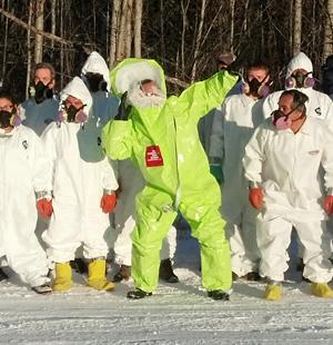 Participants in a HAZWOPER training in haz-mat suits