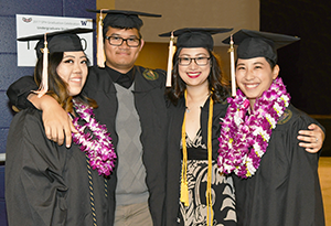 Four graduates who attended the SPH commencement ceremony.