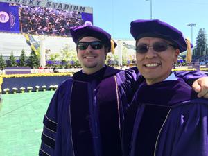 (left to right) Travis Cook (PhD, Environmental Toxicology, 2014) and Sheldwin Yazzie, a PhD candidate in Environmental and Occupational Hygiene, participate in the UW's 2015 Commencement.