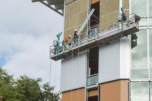 Construction workers work on the Bullitt Center
