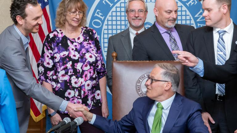 Gov. Inslee signs Senate Bill No. 5233, April 30, 2019. Relating to creating an alternative process for sick leave benefits for workers represented by collective bargaining agreements.