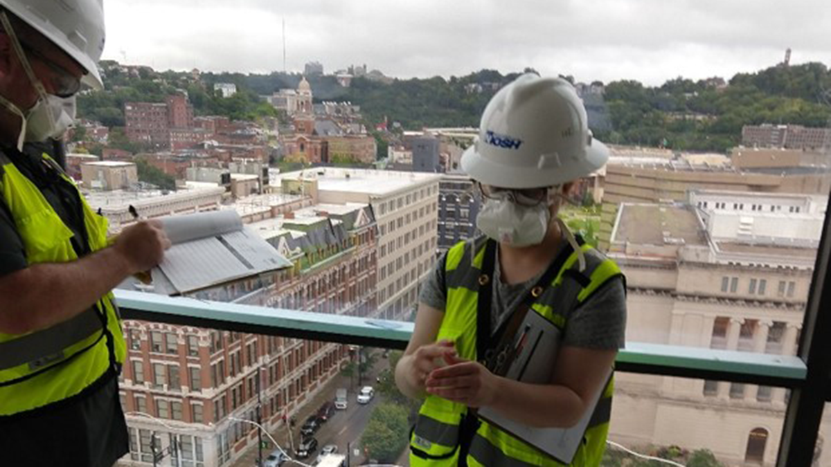 Girl working on a construction site in a NIOSH hard hat