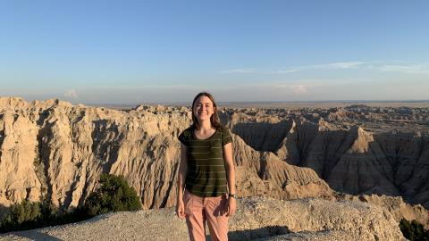 Peterson standing in front of a canyon in the Badlands.