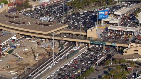 Image of the very heavy traffic across the border between the US and Mexico at San Ysidro from an aerial view.