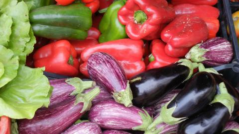 Close-up of bell peppers and eggplant.