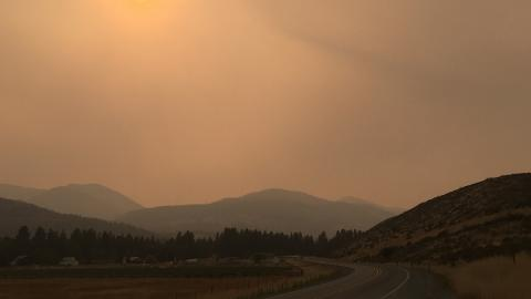 Smoky skies reduce visibility along a road in central Washington.