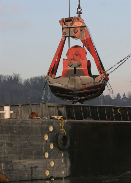 Dredge bucket over water at Duwamish River clean up site